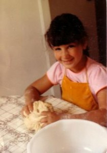 Ruth\'s daughter Joanna kneads challah dough. Photo by Ruth, Once Upon a Feast.